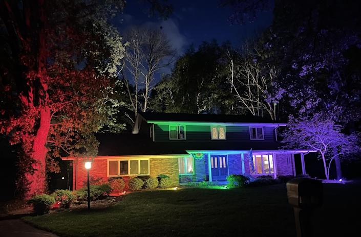 Memo Fachino and Lance Mier lit up the outside of their home in rainbow-colored flood lights to celebrate Pride Month. / Credit: Courtesy of Imgur/Memo Fachino