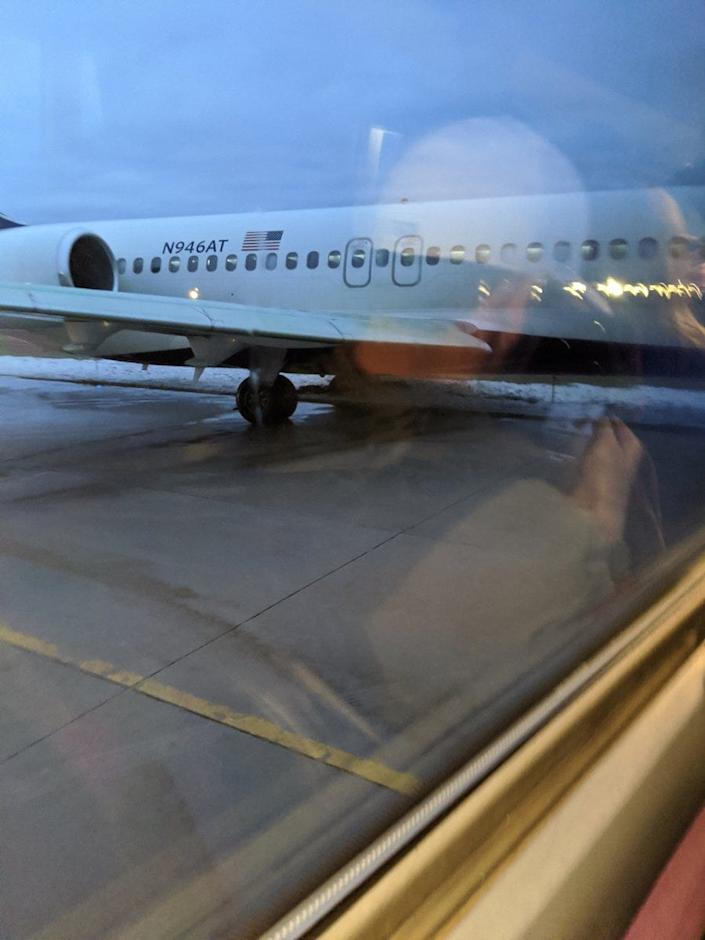 The Delta jet was carrying more than 100 passengers when it slid off the taxiway early Saturday.