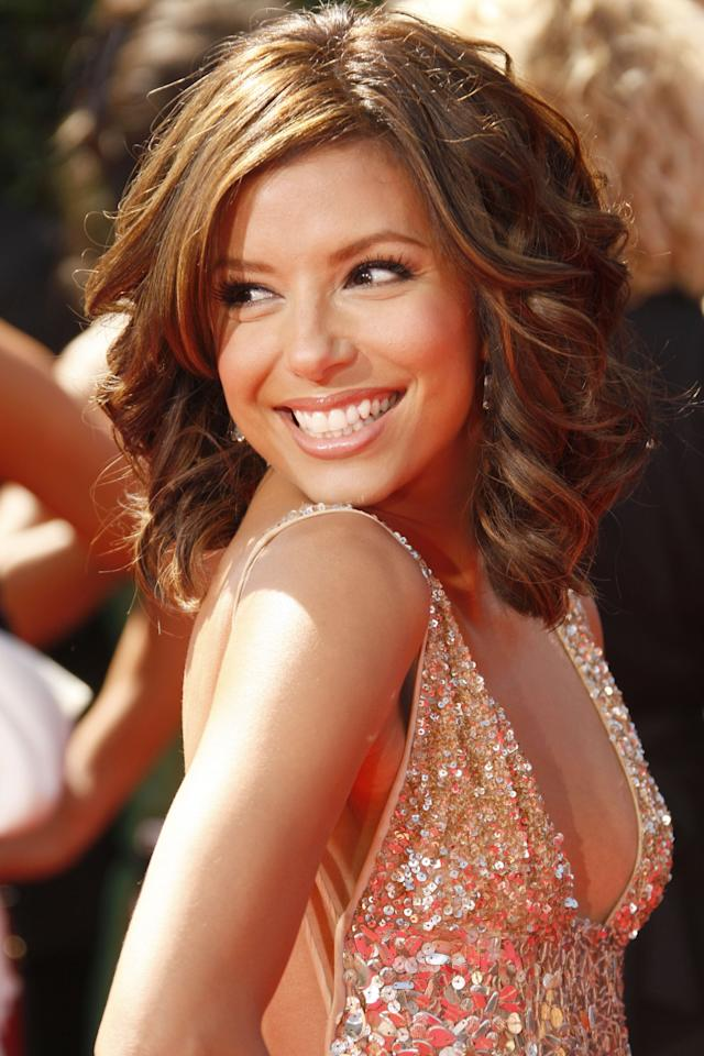 "<p>In 2007, <a class=""sugar-inline-link ga-track"" title=""Latest photos and news for Eva Longoria"" href=""https://www.popsugar.com/Eva-Longoria"" target=""_blank"" data-ga-category=""Related"" data-ga-label=""https://www.popsugar.com/Eva-Longoria"" data-ga-action=""&lt;-related-&gt; Links"">Eva Longoria</a>'s long bob haircut was given a side part and bouncy curls.</p>"