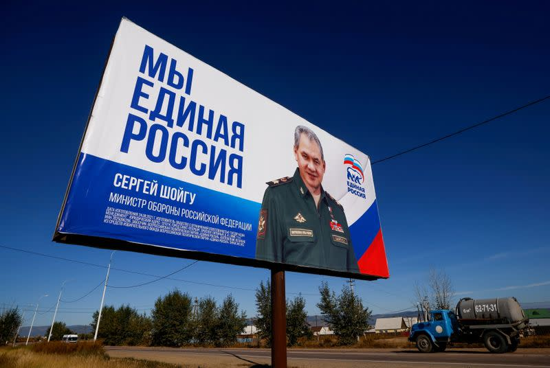 FILE PHOTO: Truck drives past a campaign poster of the United Russia political party ahead of the Russian parliamentary and regional election outside Ulan-Ude