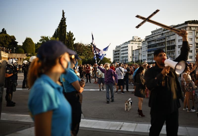 Anti-vaccine protesters take part in a demonstration outside the parliament building in Athens