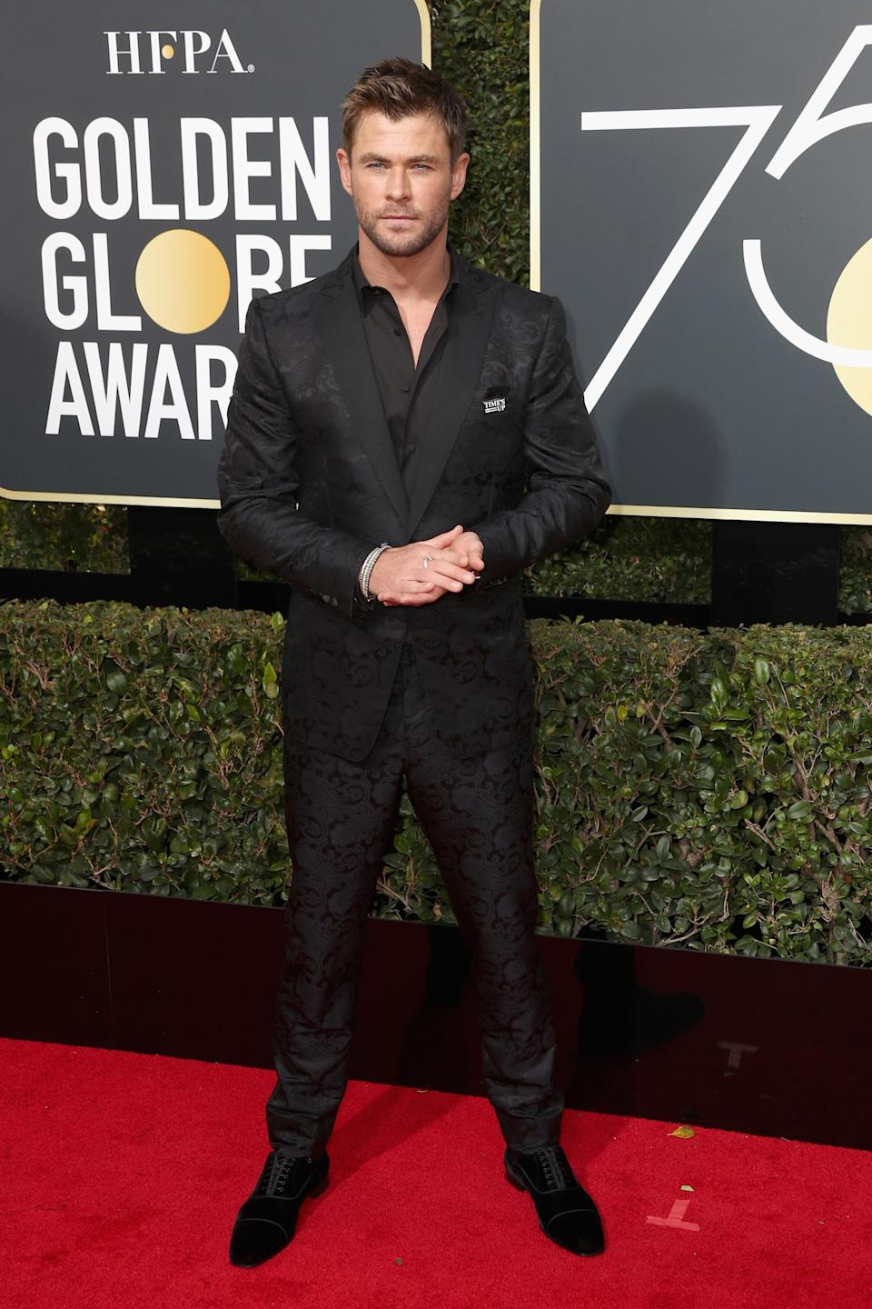 <p>Jazzing up the traditional tux, Chris Hemsworth wore a patterned Etro suit, with Christian Louboutin shoes. <em>[Photo: Getty]</em> </p>