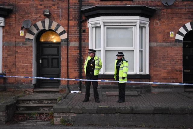 Police officers outside flats in Woverhampton Road, Stafford, where a property is being searched by following Friday's attack