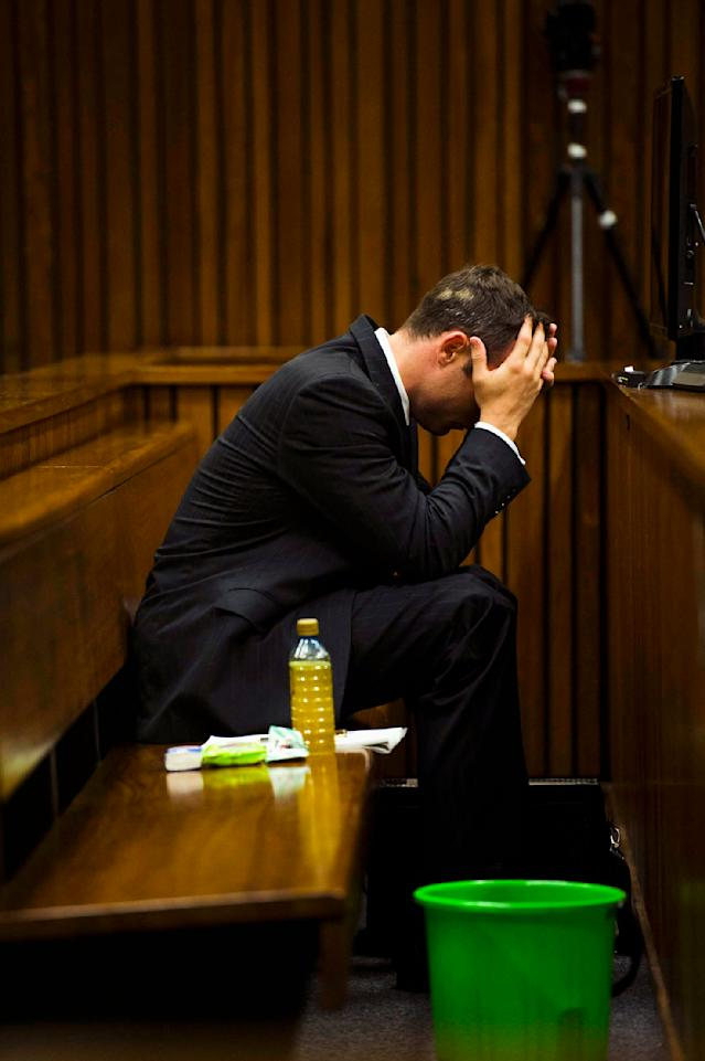 Olympic and Paralympic track star Oscar Pistorius reacts as he sits in the dock during court proceedings at the North Gauteng High Court in Pretoria, March 13, 2014. Pistorius is on trial for murdering his girlfriend Reeva Steenkamp at his suburban Pretoria home on Valentine's Day last year. REUTERS/Alet Pretorius/Media24/Pool (SOUTH AFRICA - Tags: SPORT CRIME LAW ATHLETICS TPX IMAGES OF THE DAY)