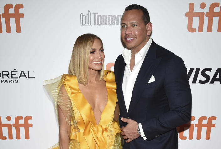 """FILE - In this Saturday, Sept. 7, 2019, file photo, Jennifer Lopez, left, and Alex Rodriguez attend the premiere for """"Hustlers"""" on day three of the Toronto International Film Festival at Roy Thomson Hall, in Toronto. Lopez and Rodriguez called off their two-year engagement, according to multiple reports based on anonymous sources. The former New York Yankees shortstop proposed to the actor a couple years ago after the celebrity couple started dating in early 2017. (Photo by Evan Agostini/Invision/AP, File)"""