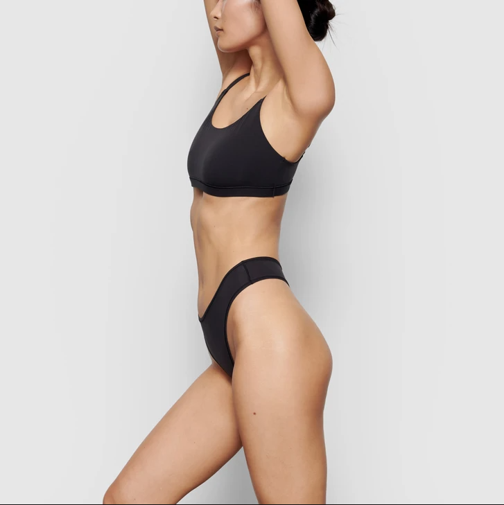 """<h2>Skims Fits Everybody Scoop Neck Bra</h2><br><strong>Size range: </strong>XXS - 4XL<br>Banish any notions of Kim Kardashian's Skims as a celeb vanity brand — the successful shapewear imprint boasts partnerships with heavyweight department stores like Nordstrom and Net-a-Porter and scores of customers accolades on its website. The brand's bralettes are beloved by customers of all bra sizes, thanks to an inclusive size range of XXS - 4XL.<br><br><strong>Skims</strong> Fits Everybody Scoop Neck Bra, $, available at <a href=""""https://go.skimresources.com/?id=30283X879131&url=https%3A%2F%2Fskims.com%2Fproducts%2Ffits-everybody-scoop-neck-bra-onyx"""" rel=""""nofollow noopener"""" target=""""_blank"""" data-ylk=""""slk:Skims"""" class=""""link rapid-noclick-resp"""">Skims</a>"""
