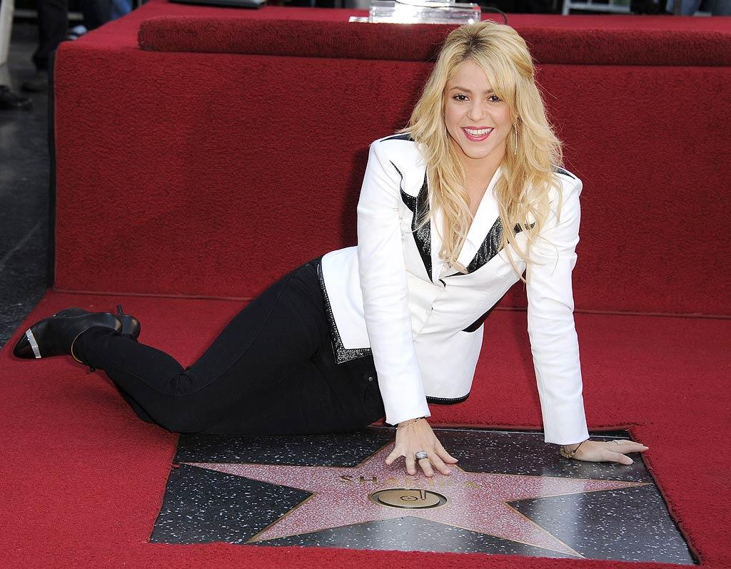 "Songstress Shakira got comfy in front of her brand new star at her Hollywood Walk Of Fame Induction Ceremony on Tuesday. ""There's a lot of people here!"" Shakira tweeted from the event, along with a picture of the giant crowd. (11/8/2011)"