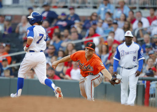 Baltimore Orioles first baseman Chris Davis (19) catches the throw to first for the out on Atlanta Braves' Dansby Swanson, ending the baseball game Saturday, June 23, 2018, in Atlanta. The Orioles won 7-5. (AP Photo/Todd Kirkland)