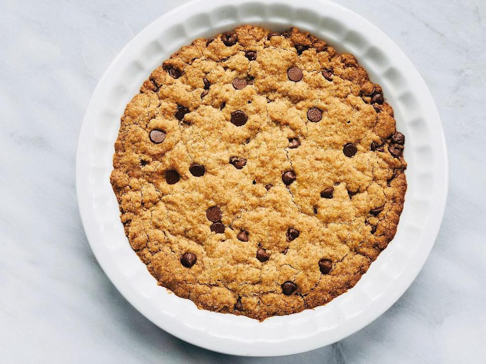 """<p>Plant-based eaters deserve a good dessert, too, and this chocolate chip cookie """"pie"""" has some creative swaps. Heck, this dish is so good, <a href=""""https://www.thedailymeal.com/cook/7-easy-recipes-help-you-go-vegan-slideshow?referrer=yahoo&category=beauty_food&include_utm=1&utm_medium=referral&utm_source=yahoo&utm_campaign=feed"""" rel=""""nofollow noopener"""" target=""""_blank"""" data-ylk=""""slk:you might even consider going vegan"""" class=""""link rapid-noclick-resp"""">you might even consider going vegan</a> after making it!</p> <p><a href=""""https://www.thedailymeal.com/recipes/vegan-cookie-pie-recipe?referrer=yahoo&category=beauty_food&include_utm=1&utm_medium=referral&utm_source=yahoo&utm_campaign=feed"""" rel=""""nofollow noopener"""" target=""""_blank"""" data-ylk=""""slk:For the Vegan Cookie Pie recipe, click here."""" class=""""link rapid-noclick-resp"""">For the Vegan Cookie Pie recipe, click here.</a></p>"""