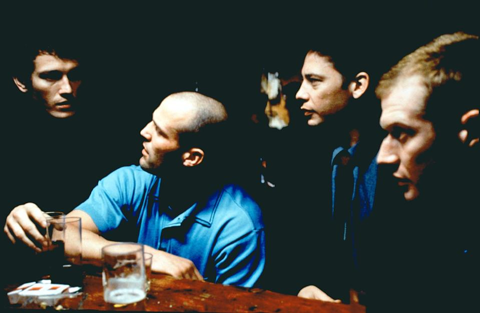 """(L-R) Nick Moran, Jason Statham, Dexter Fletcher, and Jason Flemyng in """"Lock, Stock and Two Smoking Barrels."""" For his first movie, Statham says the other actors helpfully said, """"You see that thing there, that's a mark. You try and walk and land there."""""""