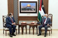 A picture provided by the Palestinian Authority on May 30 shows president Mahmud Abbas, on the right, meeting with Egypt's intelligence chief Abbas Kamel in the West Bank city of Ramallah