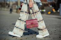 <p>Wide-leg trousers are popping up everywhere, and finding that perfect sneaker-skimming length makes it a great option for day. Pro tip: pair your sneakers with a modern structured bag to keep your look polished.</p>