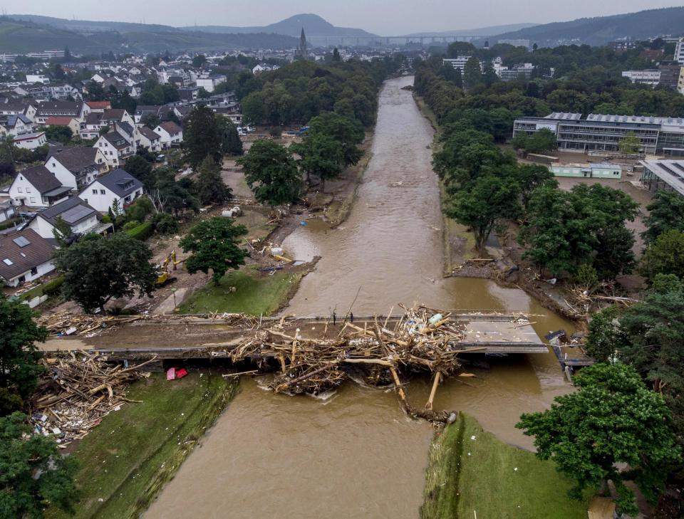 A bridge over the Ahr river is damaged in Bad Neuenahr-Ahrweiler, Germany, Saturday, July 17, 2021. Due to strong rain falls the Ahr river went over the banks and flooded big parts of the town. (AP Photo/Michael Probst)
