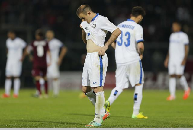 Inter of Milan's Rodrigo Palacio walks on the pitch at the end of a Serie A soccer match against Livorno in Leghorn, Italy, Monday, March 31, 2014. (AP Photo/Francesco Speranza)