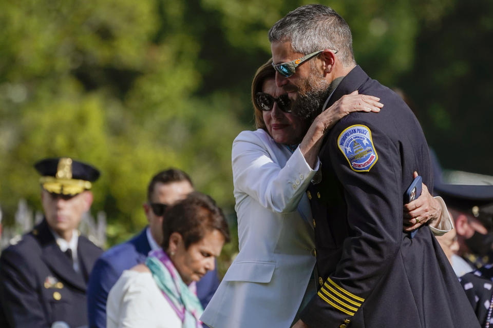 House Speaker Nancy Pelosi of Calif., hugs Washington Metropolitan Police Department officer Michael Fanone as they arrive for a bill signing that awards Congressional gold medals to law enforcement officers that protected members on Congress at the Capitol during the Jan. 6 riots, in the Rose Garden of the White House, Thursday, Aug. 5, 2021, in Washington. (AP Photo/Evan Vucci)