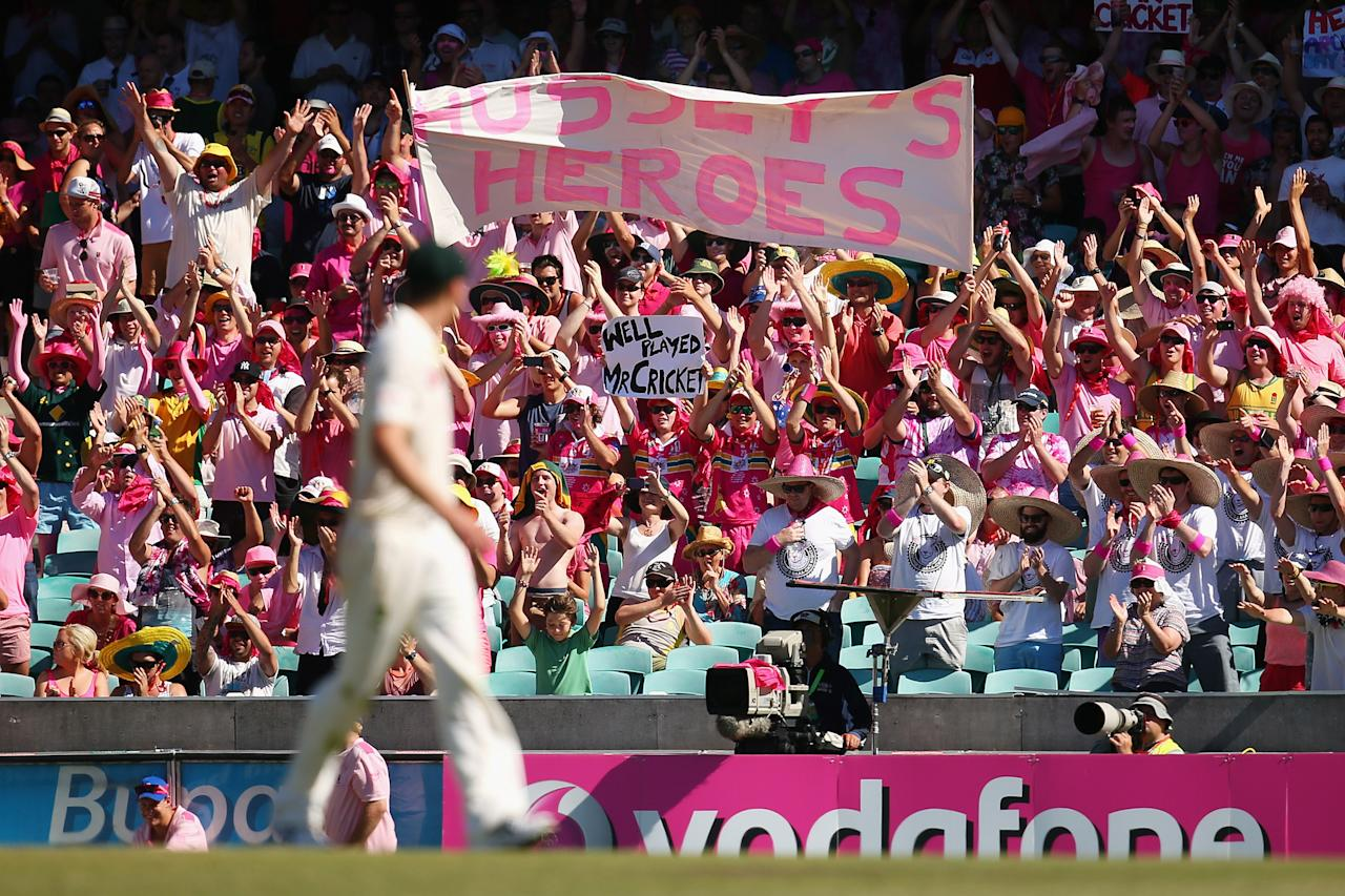 SYDNEY, AUSTRALIA - JANUARY 05: Fans hold up signs supporting Michael Hussey of Australia during day three of the Third Test match between Australia and Sri Lanka at Sydney Cricket Ground on January 5, 2013 in Sydney, Australia.  (Photo by Cameron Spencer/Getty Images)