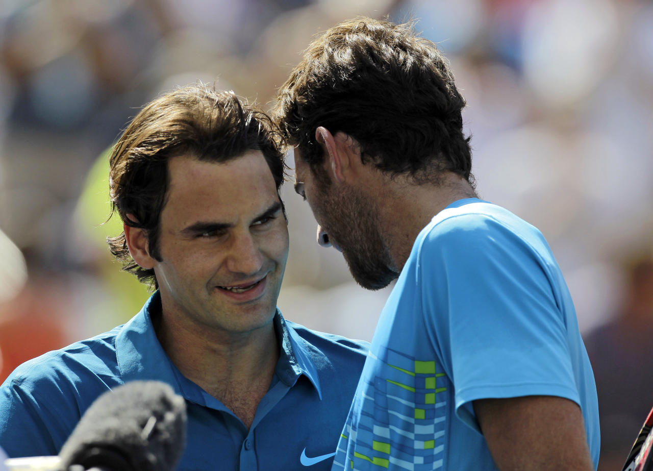 Roger Federer, left, of Switzerland, is congratulated by Juan Martin del Potro, of Argentina, after winning 6-3, 6-2 in a match at the BNP Paribas Open tennis tournament on Friday, March 16, 2012, in Indian Wells, Calif. (AP Photo/Darron Cummings)