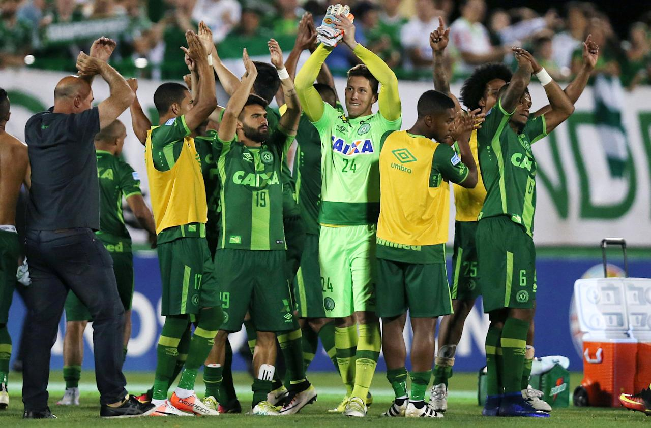 <p>Players of Chapecoense celebrate after their match against San Lorenzo at the Arena Conda stadium in Chapeco, Brazil on Nov. 23, 2016. (Paulo Whitaker/Reuters) </p>