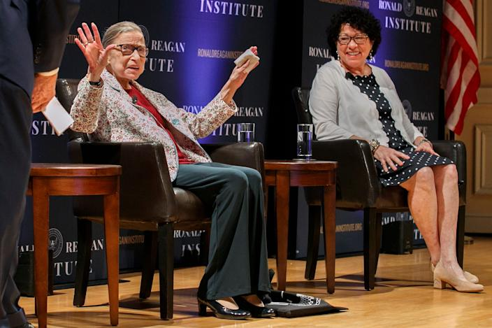"Supreme Court Justice Ruth Bader Ginsburg, left, holds up her hands as she and Supreme Court Justice Sonia Sotomayor arrive to applause for a panel discussion celebrating Sandra Day O'Connor, the first woman to be a Supreme Court Justice, Wednesday Sept. 25, 2019, at the Library of Congress in Washington. <p class=""copyright"">AP Photo/Jacquelyn Martin</p>"