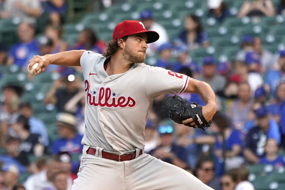 Philadelphia Phillies starting pitcher Aaron Nola delivers during the first inning of a baseball game against the Chicago Cubs Tuesday, July 6, 2021, in Chicago. (AP Photo/Charles Rex Arbogast)