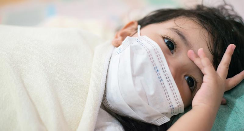 The COVID-19 outbreak has caused a global shortage in personal protection equipment, such as surgical masks, which are leaving many children with life-threatening illnesses in need. (Image via Getty Images).