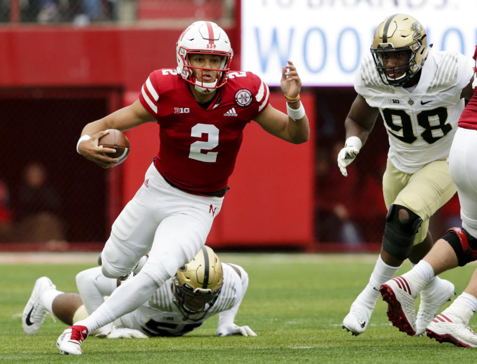 FILE - In this Sept. 29, 2018, file photo, Nebraska quarterback Adrian Martinez (2) carries the ball away from Purdue linebacker Derrick Barnes (55) and defensive end Kai Higgins (98) during the first half of an NCAA college football game in Lincoln, Neb. Ohio State hosts Nebraska on Saturday, Oct. 24, 2020. (AP Photo/Nati Harnik, File)