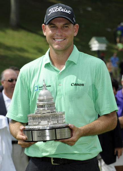 Bill Haas poses with a trophy after winning the AT&T National golf tournament at Congressional Country Club, Sunday, June 30, 2013, in Bethesda, Md. (AP Photo/Nick Wass)