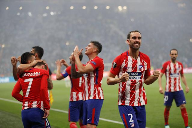 Soccer Football - Europa League Final - Olympique de Marseille vs Atletico Madrid - Groupama Stadium, Lyon, France - May 16, 2018 Atletico Madrid's Diego Godin celebrates their second goal scored by Antoine Griezmann REUTERS/Gonzalo Fuentes