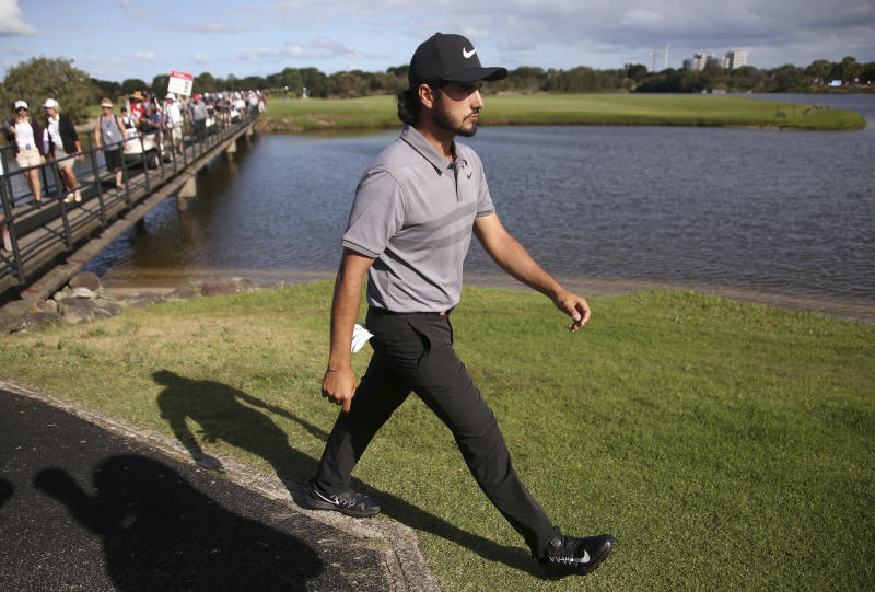 Abraham Ancer of Mexico walks on the 17th fairway on his way to winning the Australian Open Golf tournament in Sydney, Sunday, Nov. 18, 2018. (AP Photo/Rick Rycroft)