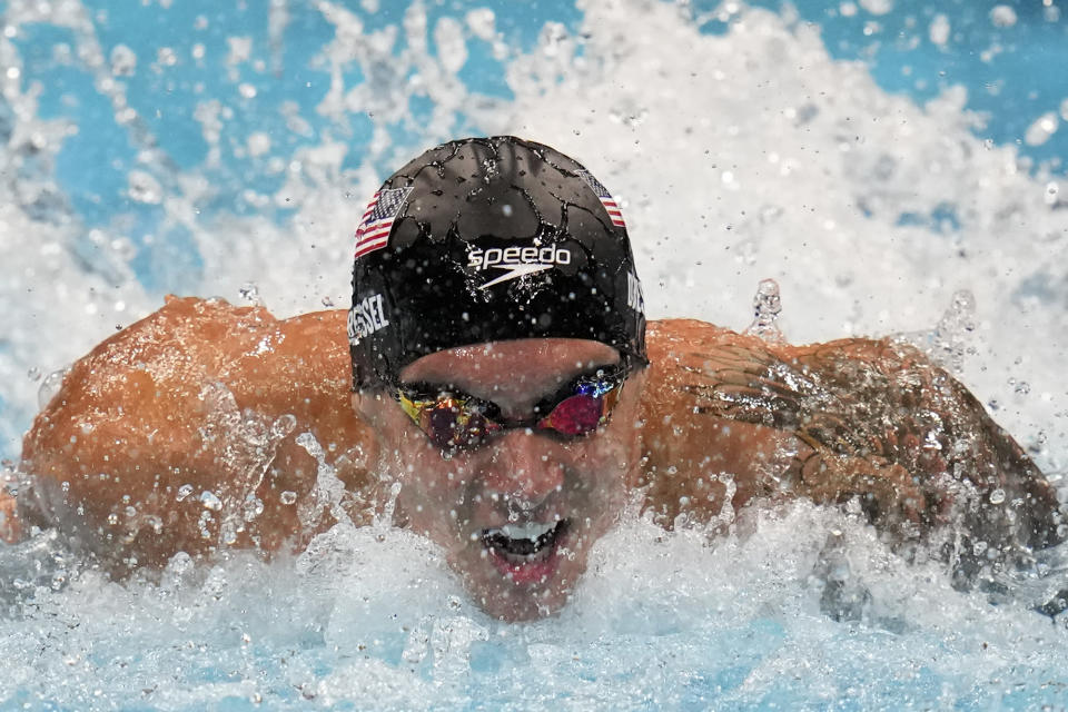 Caeleb Dressel of the United States swims in a semifinal heat of the men's 100-meter butterfly at the 2020 Summer Olympics, Friday, July 30, 2021, in Tokyo, Japan. (AP Photo/Gregory Bull)