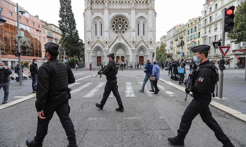 Gendarmes secure the area around the cathedral in Nice on 31 October.