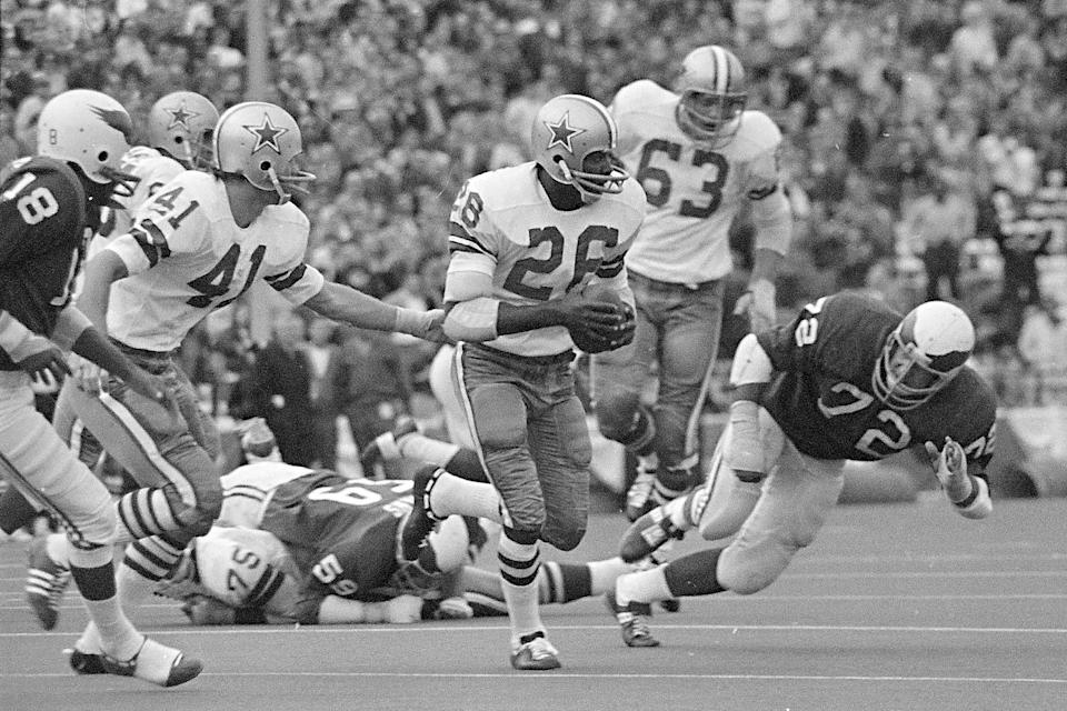 FILE - In this Nov. 1, 1970, file photo, Dallas Cowboys cornerback Herb Adderley (26) returns an interception in the fourth quarter of an NFL football game against the Philadelphia Eagles in Dallas. Hall of Fame cornerback Herb Adderley has died. He was 81. His death was confirmed Friday, Oct. 30, 2020, on Twitter by nephew Nasir Adderley, a safety for the Los Angeles Chargers. Adderley played on six NFL title teams over a 12-year career with Green Bay and Dallas. (AP Photo/File)