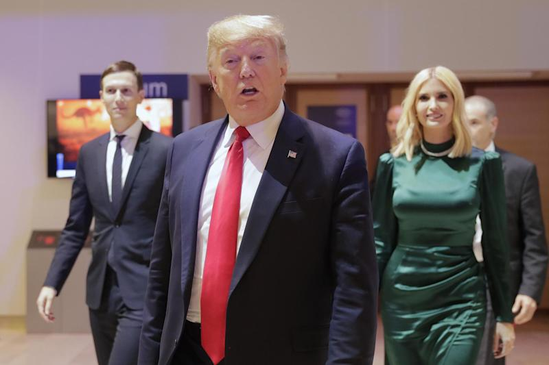 President Donald Trump leaves after attending a session at the World Economic Forum in Davos, Switzerland, as his impeachment trial in the US got under way (AP)