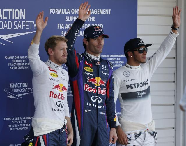 Red Bull Formula One driver Sebastian Vettel (L) of Germany, Red Bull Formula One driver Mark Webber (C) of Australia and Mercedes Formula One driver Lewis Hamilton of Britain wave after the qualifying session of the Japanese F1 Grand Prix at the Suzuka circuit October 12, 2013. REUTERS/Toru Hanai (JAPAN - Tags: SPORT MOTORSPORT F1)