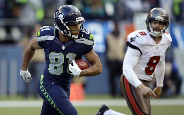 Tampa Bay Buccaneers kicker Michael Koenen, right, runs by as Seattle Seahawks punt returner Golden Tate returns one of his punts for a 71-yard run in the second half of an NFL football game Sunday, Nov. 3, 2013, in Seattle. (AP Photo/Elaine Thompson)