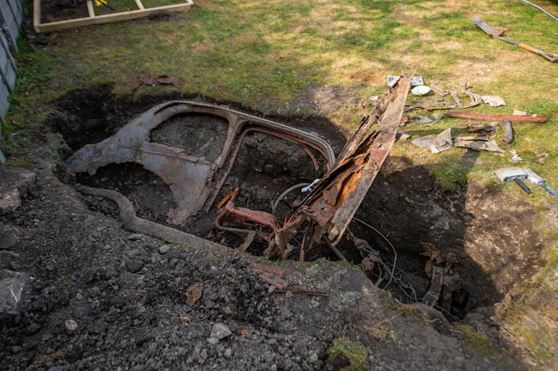 Brayshaw, 40, found the remains of the car when he was digging some decking in his garden. (Picture: SWNS)