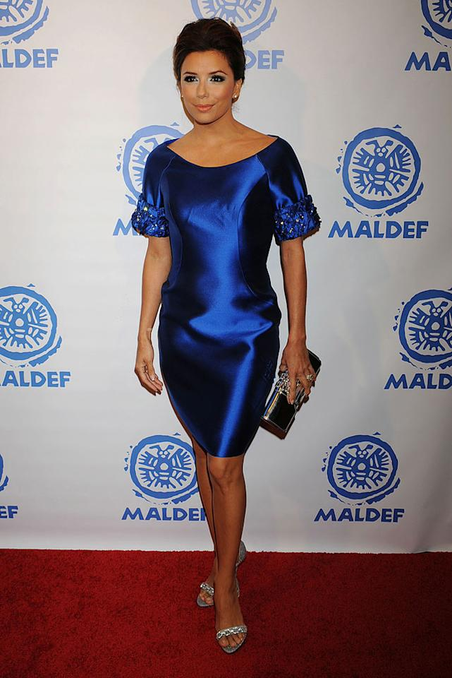 """Another celeb who recently stepped out in a matronly ensemble was """"Desperate Housewives"""" hottie Eva Longoria, who made the mistake of wearing this unflattering dud of a dress to a red carpet gala. Jeffrey Mayer/<a href=""""http://www.wireimage.com"""" target=""""new"""">WireImage.com</a> - November 12, 2009"""