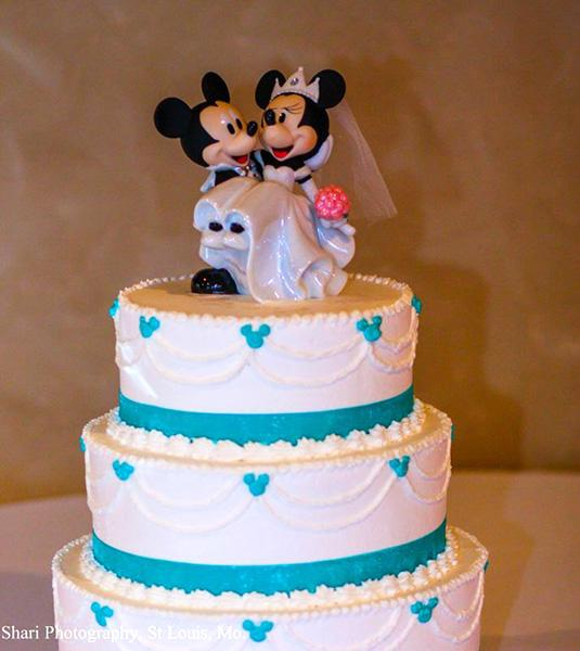 photo by:Shari Photography<br> The wedding cake was red velvet with lemon and dark chocolate and topped with Mickey and Minnie Mouse figurines.
