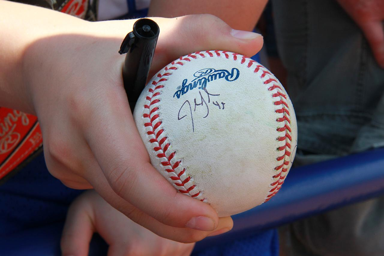 <p>A fans holds a ball signed by a player before the baseball game between the Washington Nationals and New York Mets at First Data Field in Port St. Lucie, Fla., Saturday, Feb 25, 2017. (Gordon Donovan) </p>