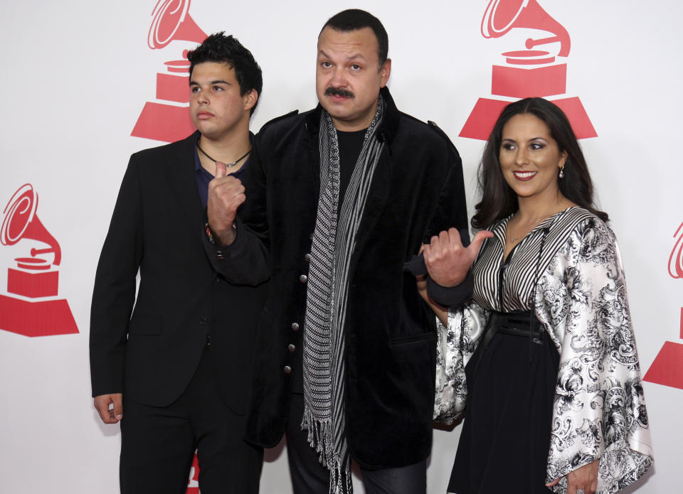 Pepe Aguilar arrives with his wife and son at the 2011 Latin Recording Academy's Person of the Year tribute dinner and concert honoring Shakira at the Mandalay Bay Resort in Las Vegas, Nevada November 9, 2011. REUTERS/Steve Marcus (UNITED STATES - Tags: ENTERTAINMENT)