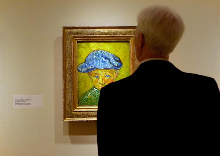 """A visitor studies Vincent van Gogh's """"Portrait of Camille Roulin,"""" on display at The Phillips Collection in Washington. In the midst of the shutdown of federally funded museums, the private Phillips Collection is launching the first major exhibition of Vincent van Gogh's artwork in Washington in 15 years. (AP Photo/Molly Riley)"""
