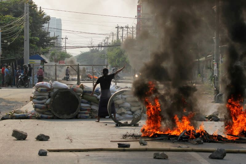 FILE PHOTO: Demonstrators gather behind barricades during a protest against the military coup in Mandalay