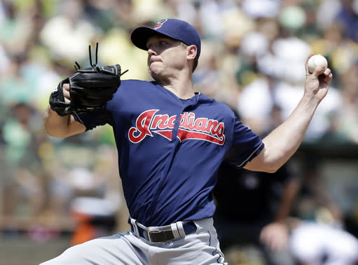 Cleveland Indians starting pitcher Scott Kazmir throws to the Oakland Athletics during the first inning of a baseball game on Sunday, Aug. 18, 2013, in Oakland, Calif. (AP Photo/Marcio Jose Sanchez)