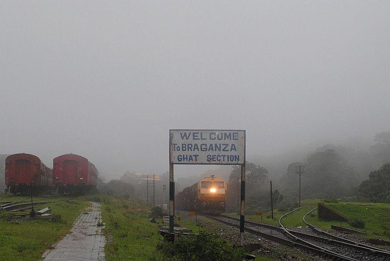 Welcome to Braganza, the sign announces the beginning of the trek. A yellow-cream WDG-4 #12010 loco works hard as it completes the hard climb up the Ghats. The Braganza Ghats section, on the Castle Rock-Kulem section of the South Western Railways, has gradients that necessitate the usage of locomotives with Auto Emergency Brakes.