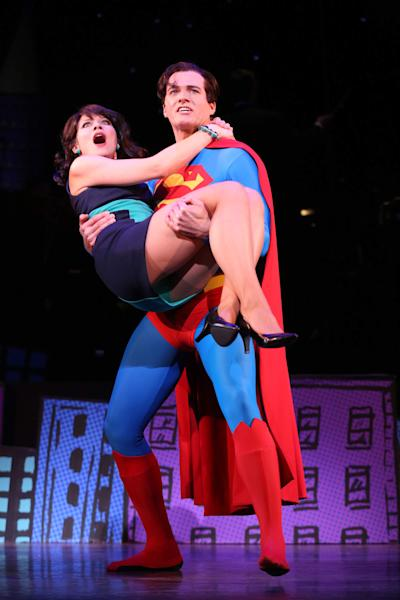 """This undated image released by Helene Davis Public Relations shows Jenny Powers as Lois Lane, left, and Edward Watts as Superman in Encore's """"It's A Bird It's A Plane It's Superman,"""" performing through March 24 at New York City Center in New York. (AP Photo/Helene Davis Public Relations, Joan Marcus)"""