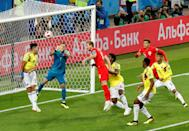 <p>Colombia goalkeeper David Ospina punches the ball clear with Harry Kane lurking </p>