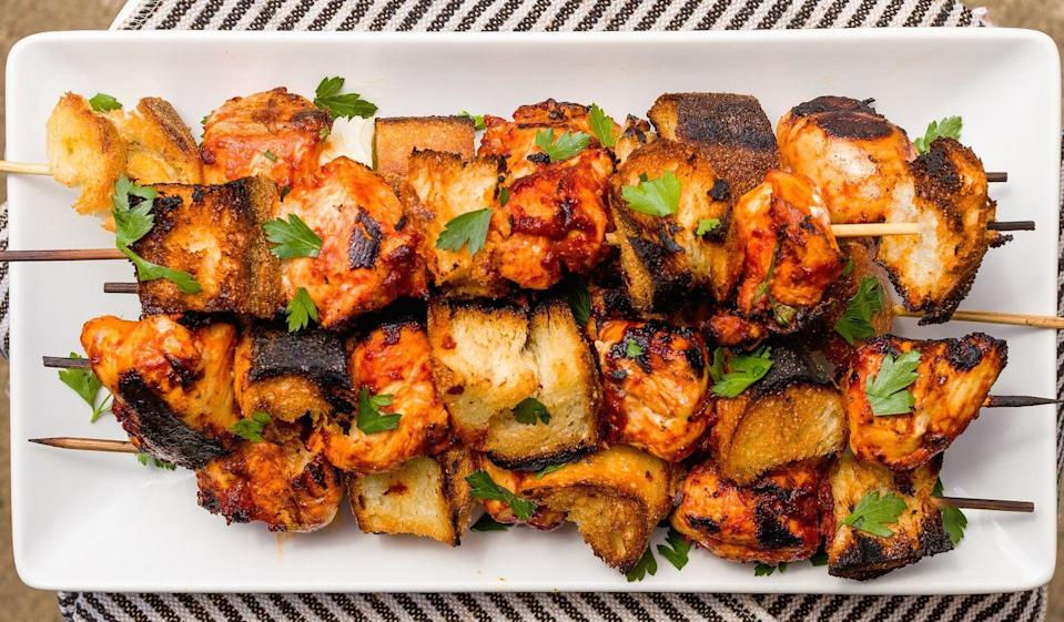 """<p>Marinate the chicken in a quick savory mixture of tomato paste, olive oil, lots of garlic, and fresh parsley for the perfect accompaniment to grilled bread.</p><p>Get the recipe from <a href=""""https://www.delish.com/cooking/recipe-ideas/recipes/a43679/italian-chicken-skewers-recipe/"""" rel=""""nofollow noopener"""" target=""""_blank"""" data-ylk=""""slk:Delish"""" class=""""link rapid-noclick-resp"""">Delish</a>.</p>"""
