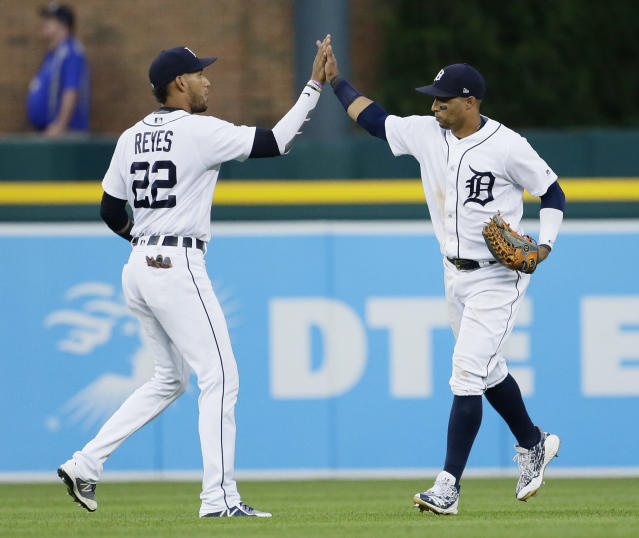 Detroit Tigers' Victor Reyes celebrates the team's 2-1 win over the Cleveland Indians with Leonys Martin after a baseball game Saturday, July 28, 2018, in Detroit. (AP Photo/Duane Burleson)