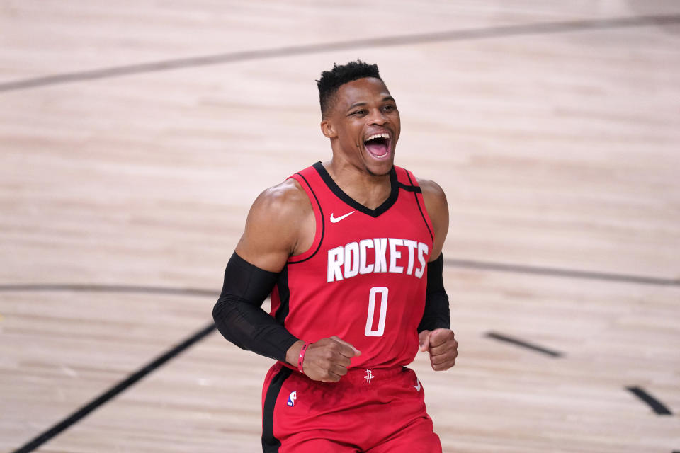 Houston Rockets' Russell Westbrook yells as he runs onto the court before an NBA conference semifinal playoff basketball game against the Los Angeles Lakers Thursday, Sept. 10, 2020, in Lake Buena Vista, Fla. (AP Photo/Mark J. Terrill)