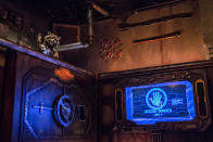 <p>Rocket (voiced by Bradley Cooper) has used his preternatural escape abilities to free himself from his cell and is ready to spring his fellow Guardians. (Photo: Disneyland Resort) </p>